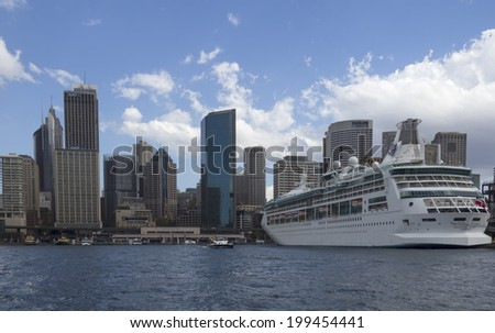 Sydney, Australia- 23th March 2013: The cruise ship Rhapsody of the Seas docked in Sydney Harbour. The ship is a Vision class cruise ship operated by Royal Caribbean International. - stock photo
