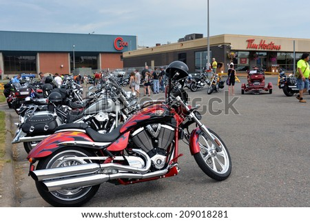 SYDNEY, CANADA - AUG 2:  Thousands of motorcycle enthusiasts gather for the first annual Cape Breton Bike Rally, a four day event, held mainly at Centre 200 on August 2, 2014 in Sydney, Nova Scotia - stock photo