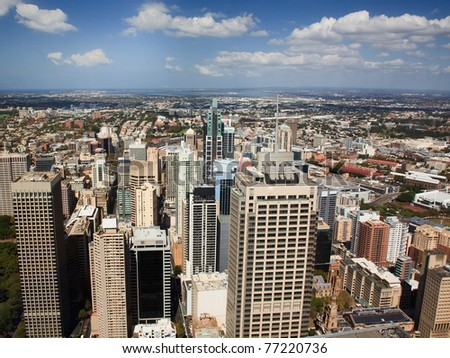 sydney city aerial view from tower to tall skyscrapers and surrounding suburbs sunny summer day - stock photo