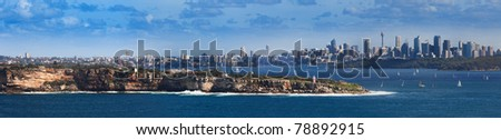 sydney city and suburbs panoramic view from north point, harbour entrance, south head, lighthouse and sail yachts - stock photo
