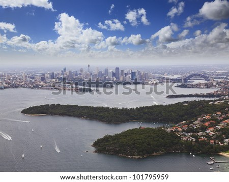 sydney city CBD and harbour bridge view from Helicopter across sydney sunny day Australia landmarks aerial hight - stock photo