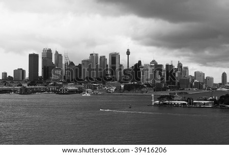 Sydney City CBD cilyline view over Harbor black-white cloudy weather - stock photo