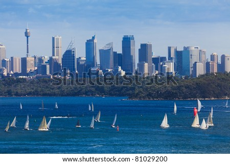 Sydney city CBD cityscape day view from milsons point across harbour with bridge blue water and sky north head - stock photo