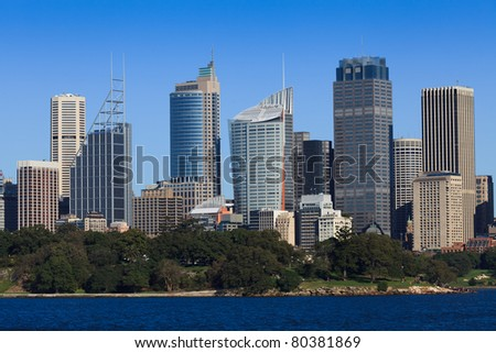 sydney city cbd close view from harbour over royal botanic garden at tall landmark skyscrapers sunny day