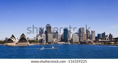 Sydney city CBD panoramic view sunny summer day blue sky and water over harbour australia landmark - stock photo
