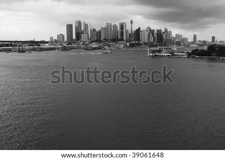 Sydney City CBD skyline view over Harbor black-white cloudy weather - stock photo