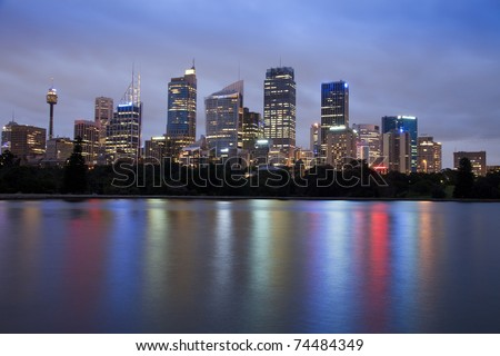 sydney city CBD skyscrapers cityscape at dusk twilight time illuminated office buildings water reflection - stock photo