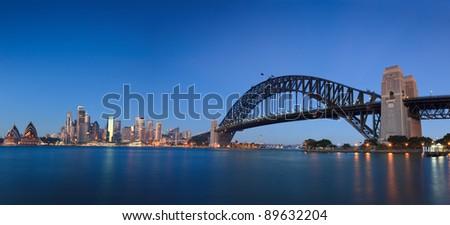 Sydney city landmark places panoramic view at sunrise: CBD, harbour bridge, skyscrapers, houses - stock photo