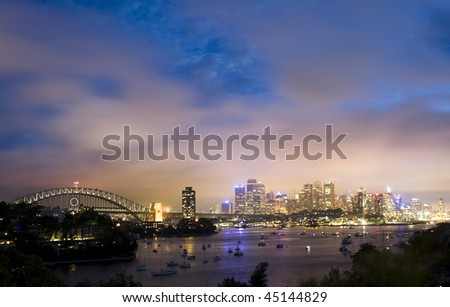 Sydney city panorama night view light illumination cityline famous place harbor highlights blue sky - stock photo