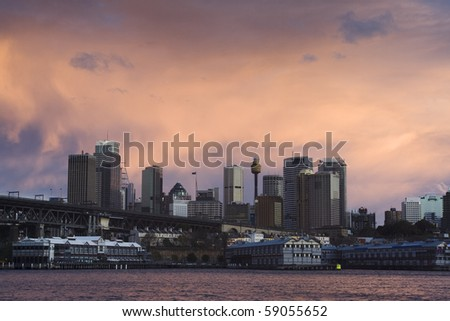 sydney city quay CBD skyscrapers under red cloudy sky during sunset thunderstorm weather - stock photo