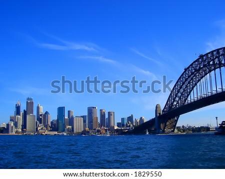 Sydney city scape and harbour bridge - stock photo