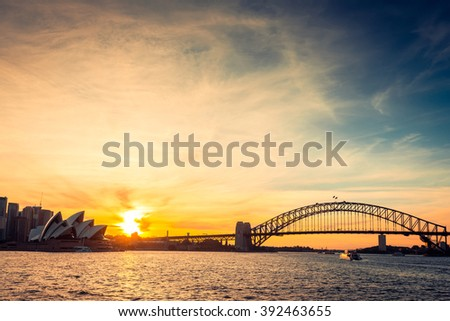 Sydney city silhouette at sunset. Cross-processing and color toning effects applied - stock photo
