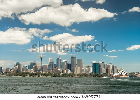 Sydney city skyline on a bright day. View from ferry - stock photo