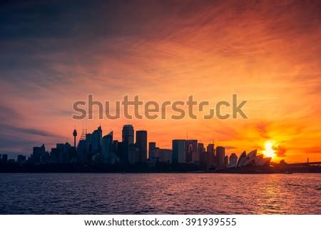 Sydney city skyline silhouette at sunset, NSW, Australia.  - stock photo