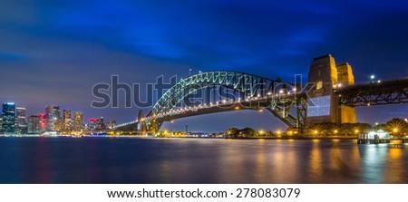 Sydney City Skyline, Sydney Harbour Bridge with Opera House with Reflection under blue sky at night in Summer, Australia - stock photo