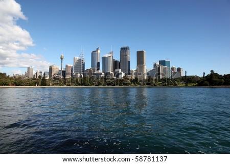 Sydney City Skyline view across farm cove. Sydney is Australia's largest city and a popular tourist destination. - stock photo