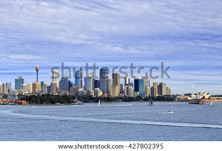 Sydney cityscape of CBD high-rise buildings towers and landmarks seen across Harbour from Bradley's head on a sunny day. BLue water and sky. - stock photo