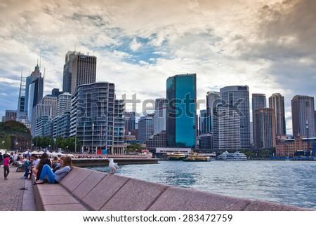 SYDNEY - DECEMBER 26: Sydney city circular quay sunset lights and illumination blue cloudy dusk. December 26, 2011 in Sydney, Australia.  - stock photo