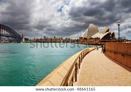 SYDNEY - DECEMBER 10: Sydney Opera House and Harbour Bridge on December 10, 2008 in Sydney, Australia. The Opera House is Unesco World Heritage Site and one of the world's famous landmarks - stock photo