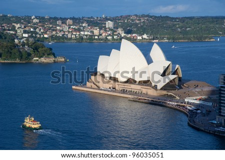 SYDNEY - DECEMBER 22: Sydney Opera House view on December 22, 2011 in Sydney, Australia. The Sydney Opera House is a famous arts center. It was designed by Danish architect Jorn Utzon. - stock photo