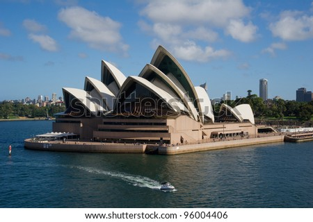 SYDNEY - DECEMBER 24: Sydney Opera House viewed from ship on December 24, 2011 in Sydney, Australia. The Sydney Opera House is a famous arts center. It was designed by Danish architect Jorn Utzon. - stock photo