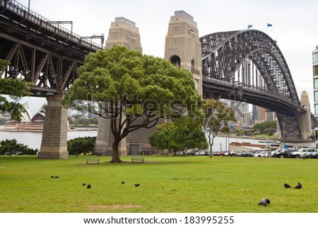 SYDNEY - DECEMBER 7: The Sydney Harbour Bridge in Sydney, Australia on December 7, 2011 is the world's widest long-span bridge.  - stock photo