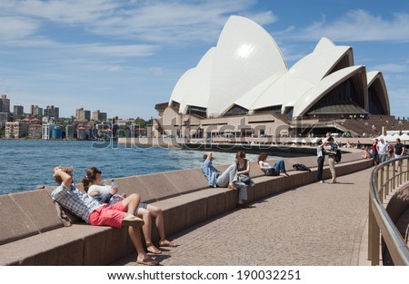 SYDNEY - DECEMBER 15: Tourists, and the Iconic Sydney Opera House. Is a multi-venue performing arts centre also containing bars. December 15, 2011 in Sydney, Australia.  - stock photo