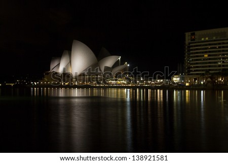 SYDNEY - FEB. 20: Sydney Opera House in Sydney at night on Feb. 20th 2013. The Opera House was made a UNESCO World Heritage Site on 28 June 2007 and is one of the world's most famous landmarks. - stock photo