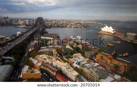 SYDNEY, February 10, 2008 - Elevated summer view of Sydney Harbour including Sydney harbour bridge and the Sydney Opera House.  Photographed in Sydney, Australia on 10 February, 2008 - stock photo