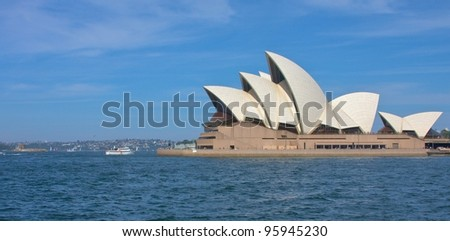 SYDNEY - FEBRUARY 19: Sydney Opera House view on February 19, 2012 in Sydney. The Sydney Opera House is a famous arts center. It was designed by Danish architect Jorn Utzon, finally opening in 1973. - stock photo