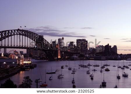 Sydney Harbour Bridge And City Skyline At Sunset, Australia - stock photo