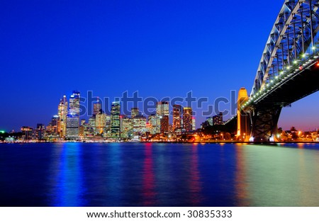 Sydney Harbour Bridge and the CBD at night - stock photo