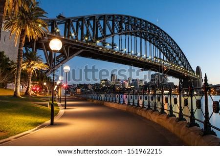 Sydney Harbour Bridge at dusk in Sydney, Australia - stock photo