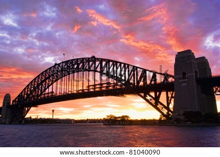 Sydney Harbour Bridge At Dusk with firing sky in background - stock photo