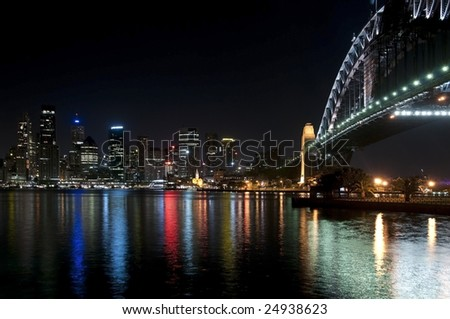 Sydney Harbour Bridge at night, as viewed from the north side of the bridge looking towards the city of Sydney - stock photo