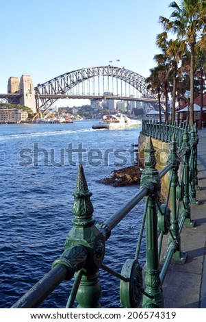 Sydney Harbour Bridge from Circular Quay with railings detail and North Sydney in the background. - stock photo