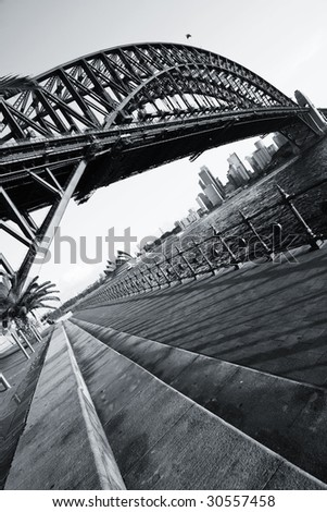 Sydney Harbour Bridge just before sunset. Tilted perspective and blue toned. - stock photo