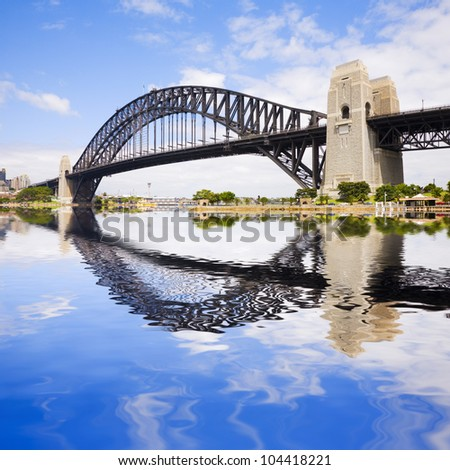 Sydney Harbour Bridge on a beautiful sunny summer day, with a Photoshop reflection in the harbour. - stock photo