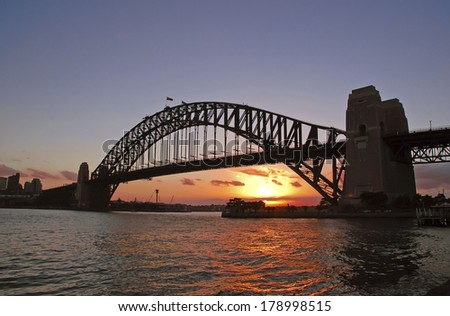 Sydney Harbour Bridge with City Skyline at Sunset, Sydney, Australia  - stock photo