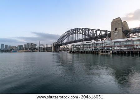 Sydney Harbour Bridge with City sunrise at Walsh Bay, Sydney, Au - stock photo