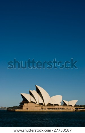 SYDNEY HARBOUR - JAN 19 : Sydney Opera House in Sydney, Australia on January 19, 2009.  40 years after designer Joern Utzon was forced off the site, he has been honored at a memorial service. - stock photo
