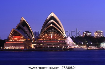 SYDNEY HARBOUR - MARCH 21 : Sydney Opera House at dusk in Sydney Harbour, Australia on March 22, 2009. The 35 years old Opera House is due for refurbishment to maintain its reputation. - stock photo