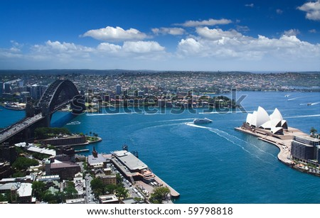 Sydney harbour opera house and downtown panoramic view from bird fly high - stock photo