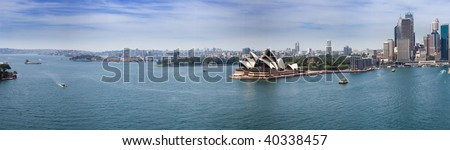 Sydney harbour opera house and downtown panoramic view from bridge - stock photo