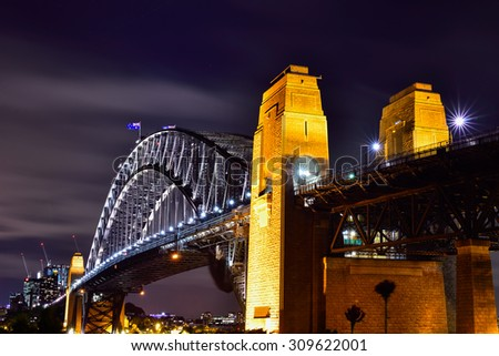 Sydney Harbour viewed from Kirribilli in North Sydney at night - stock photo