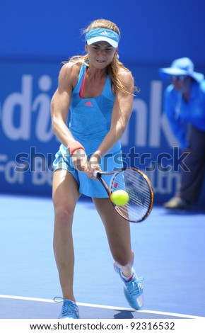 SYDNEY - JAN 9: Daniela Hantuchova of Slovakia hits a backhand in her first round match in the APIA Tennis International. Sydney - January 9, 2012 - stock photo