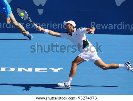 SYDNEY - JAN 13: France's Julien Benneteau reaches for a forehand at the APIA Tennis International. Sydney - January 13, 2012 - stock photo