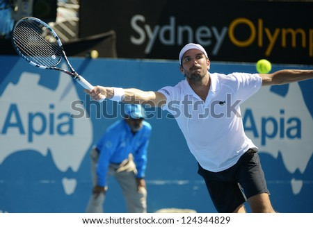 SYDNEY - JAN 11: Julien Benneteau from France stretches to return serve in the semi finals of the APIA Sydney Tennis International. Sydney January 11, 2013. - stock photo