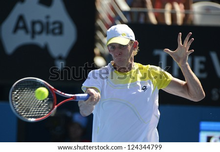 SYDNEY - JAN 11: Kevin Anderson of South Africa hits a forehand in his semi final match at the APIA Sydney Tennis International. Sydney January 11, 2013.