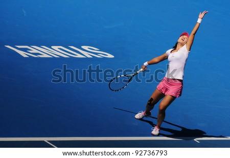 SYDNEY - JAN 12: Li Na of China serving at the APIA Tennis International. Sydney - January 12, 2012 - stock photo